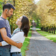 Young Couple Walking in autumn park — Stock Photo #7227505