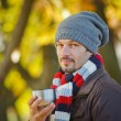 Royalty-Free Stock Photo: Man drinks tea in autumn park
