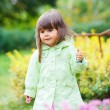 Little girl in red making funny face. — Stock Photo #7360365