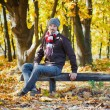 Man in autumn park - Stock Photo