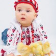 Little Girl With Easter Eggs And Baby Chickens — Stock Photo