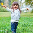 Little girl in silver walking park. — Stock Photo