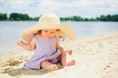 Little cute girl on the beach — Stock Photo