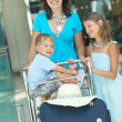 Mom and child in the airport — Stock Photo