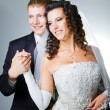 Stock Photo: Just married groom and bride on gray
