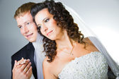 Just married groom and bride on gray — Stock Photo