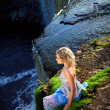 Stock Photo: Beautiful girl on brink of precipice of river waterfalls