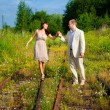 Romantic walk along the railway - Stock Photo