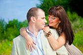 Happy enamoured couple embracing — Stock Photo