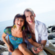 Foto de Stock  : Laughing couple near of blue sea