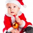 Little cute baby gnome in red with golden ball — Stock Photo