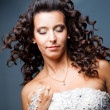 Attractive bride with long curly hair — Stock Photo #7279132