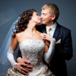 Stock Photo: Kissing bride and groom