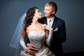 Bride and groom embracing and looking at each other — Stock Photo