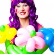 female clown with colorful balloon flowers — Stock Photo