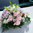 Bouquet on the wedding car — Stock Photo