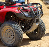 Red quad bike in the desert. — Stock Photo