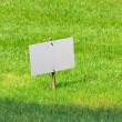 White board on lawn — Stok fotoğraf