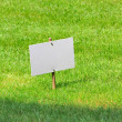 White board on lawn — ストック写真