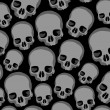 Stock Vector: Skulls background