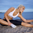 Fitness woman stretching — Stock Photo