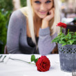 Flirting woman on restaurant - Stock Photo