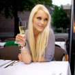 Beautiful woman drinking champagne — Stock Photo