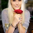 Woman with a red rose — Stok Fotoğraf #6849701