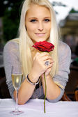Woman with a red rose — Stockfoto