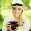 Cute girl with camera — Lizenzfreies Foto