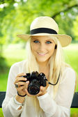 Cute girl with camera — Stock Photo