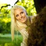 Beautiful woman playing hide and seek — Stock Photo #6993045