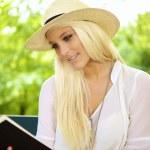 Smiling female reading — Stock Photo