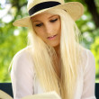 Portrait of cute female reading — Stock Photo