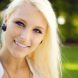 Portrait of blonde young woman outdoors — Stok fotoğraf