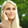 Radiant Young Woman On Mobile Phone — Stock Photo