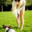 Woman Playing Wiith Dog In Park — Stock Photo