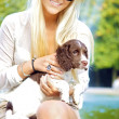 Sexy Blonde Woman Holding Dog — Stock Photo