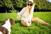 Laughing Woman Entices Dog — Stock Photo