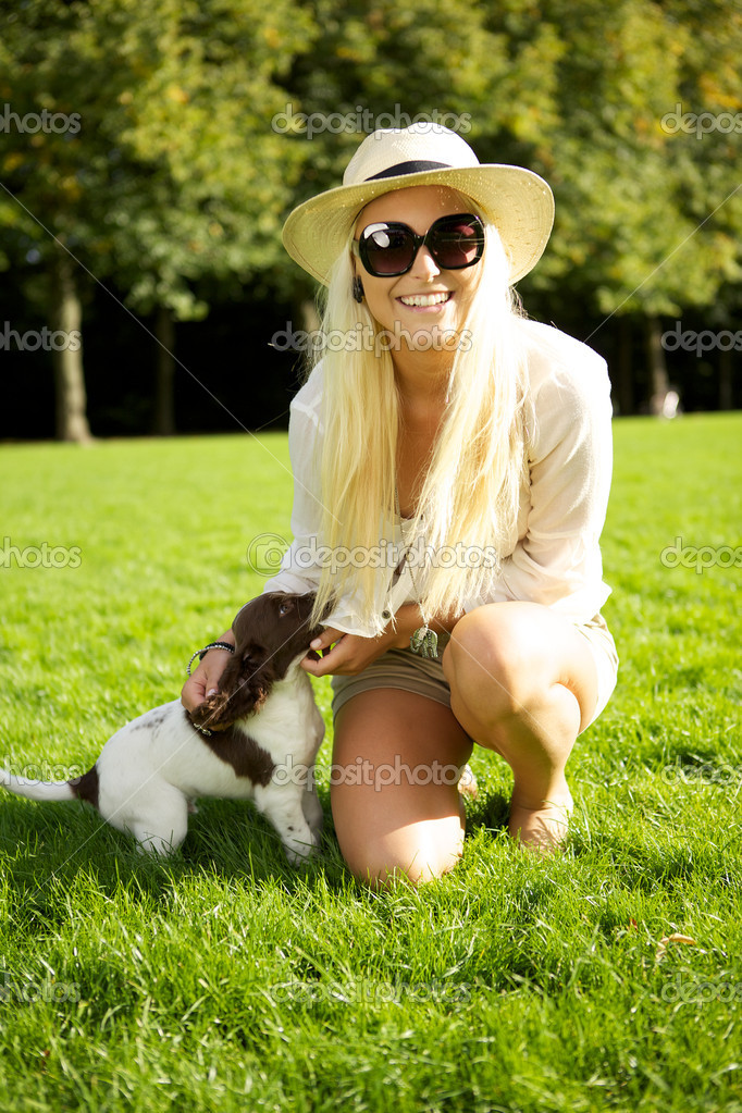 depositphotos 7346074 Sexy Blonde Woman With Puppy A vivacious sexy young blonde woman in hat and sunglasses relaxes with her ...