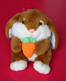 Hare Toy is sitting with Carrot — Stock Photo