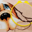 Cross stitching in progress - Stock Photo