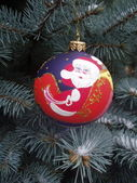 Decorative chrristmas ball on a fir tree — Stock Photo