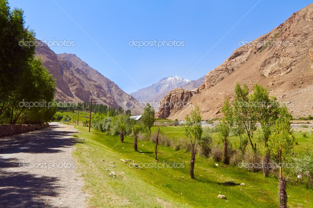 The road in valley of Pamirs. View of afghan mountains  Stock Photo #6755954