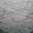 Stock Photo: Weathered concrete floor bricks