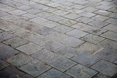 Weathered concrete floor bricks — Stock Photo
