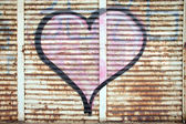 Graffiti on a iron wall — Stock Photo