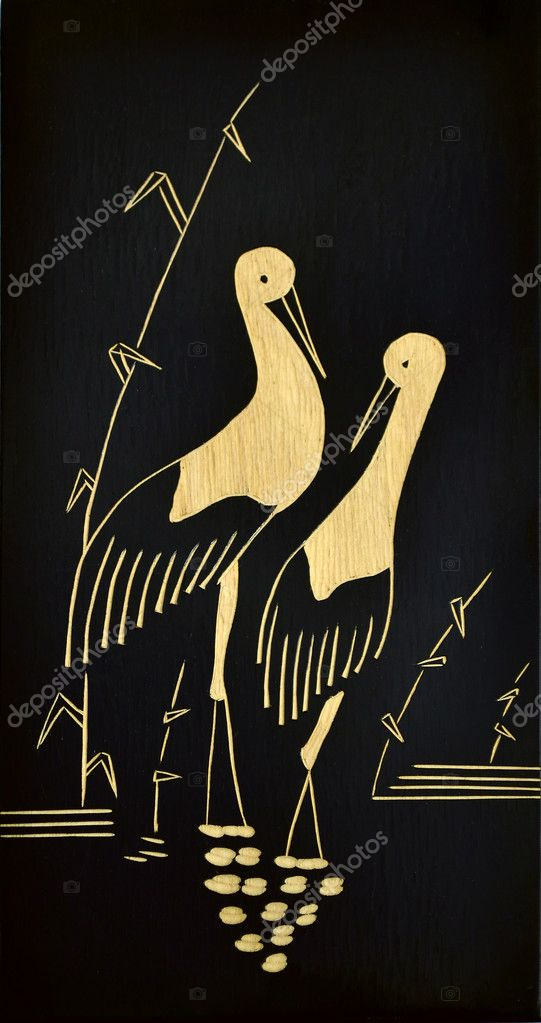 A wooden picture of a stork couple — Stock Photo #6850090