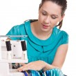 Girl in a blue dress on the sewing machine darning — ストック写真