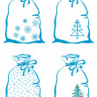 Christmas symbols on bags — Stock Photo